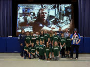 Briargreen Primary School students with Tim Peake on the big screen